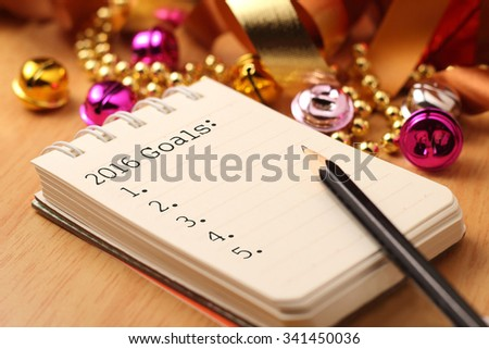 New Year's goals with colorful decorations. New Year's goals are resolutions or promises that people make for the New Year to make their upcoming year better in some way. - stock photo