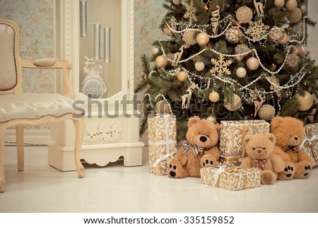 New Year's interior. Christmas tree. Christmas. Christmas tree. gifts and toys under the Christmas tree. Christmas decorations. Luxury , bright, clean bright beautiful home interiors. - stock photo