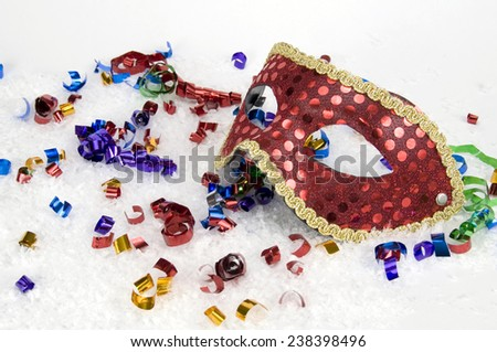 New Year's Masked Party with Red Mask - stock photo