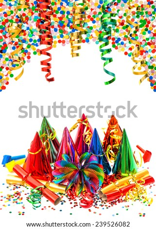 New Year's party decoration. multicolored garlands, streamer, hats and confetti on white  background - stock photo