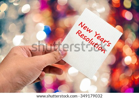 New Year's  Resolution handwriting on a sticky note - stock photo
