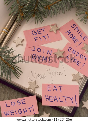 New Year's resolutions in the holiday arrangement - stock photo