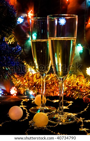 New Year's still-life with champagne and a lighting garland