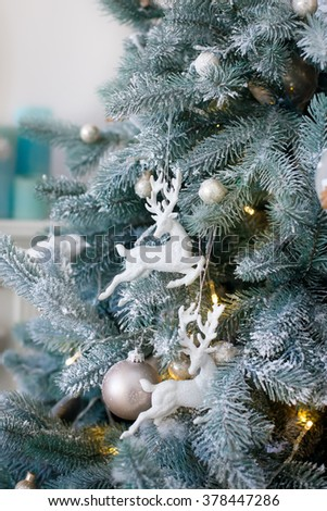 New Year's toys on a blue fir-tree. Christmas tree background - stock photo