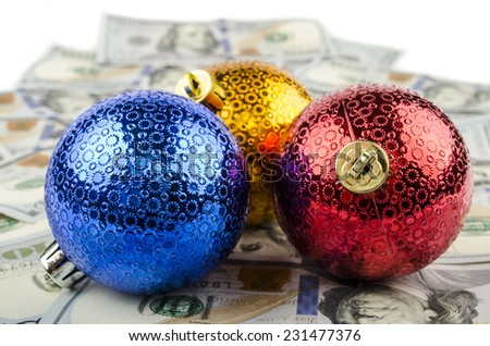 New Year's toys on the dollar bill - stock photo