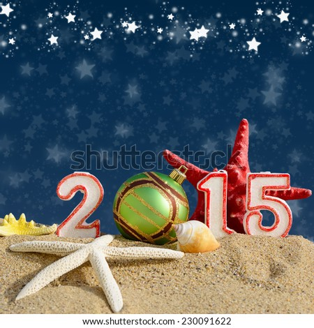 New year 2015 sign on a beach sand - stock photo