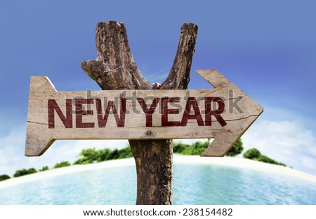 New Year sign with a beach on background - stock photo