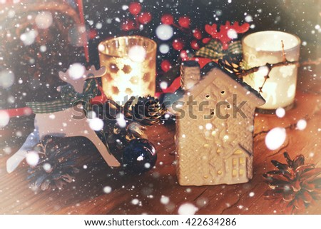 new year snow table with pine cone and candle  - stock photo