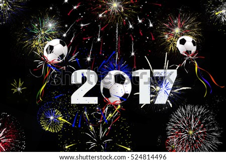 New Year 2017 soccer ball balloons and fireworks in midnight black sky