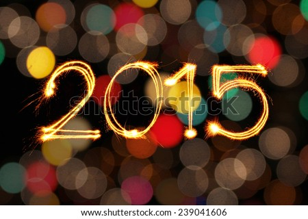 New year 2015 sparkles firework with dirty defocused light blur bokeh background - stock photo