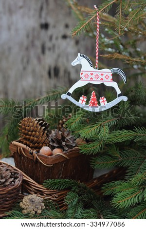 New Year toy of horse on Cristmas tree in sunlight  - stock photo