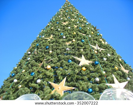 New year tree and blue sky - stock photo