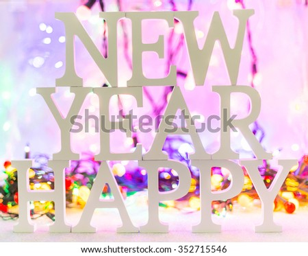 New year white wood character over Defocused bokeh christmas light and christmas balls background - stock photo