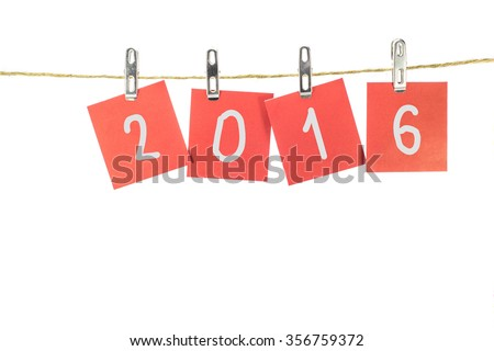 new year 2016 word hanging on the Notes paper cards in clothes pegs on rope with isolate - stock photo
