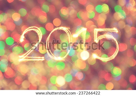 New Year 2015 writing with Defocused light blur bokeh background in Vintage tone - stock photo