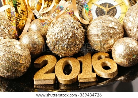 New Years Eve 2016 golden numbers surrounded by shiny decorations - stock photo