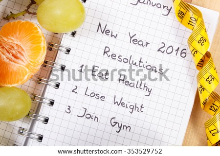 New years resolutions eat healthy, lose weight and join gym written in notebook and fruits with tape measure, concept of healthy lifestyle - stock photo