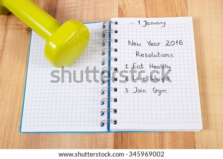 New years resolutions eat healthy, lose weight and join gym written in notebook, dumbbells for fitness, concept of healthy lifestyle - stock photo