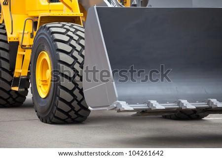 New yellow bulldozer - stock photo
