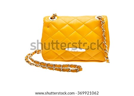 New yellow womens bag isolated on white background.
