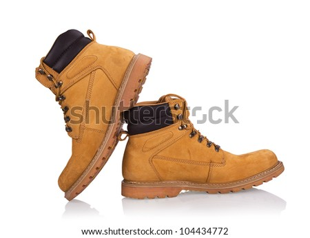 New yellow working boots isolated on white - stock photo