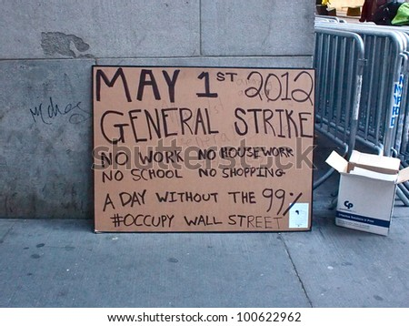 "NEW YORK - APR 12: A ""General Strike"" sign made by Occupy Wall Street demonstrators leans against a building April 12, 2012 in New York City, NY. Protesters planned a major action for May 1. - stock photo"
