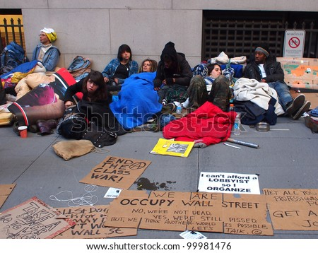 NEW YORK - APR 13: Occupy Wall Street activists camp out on Wall Street April 13, 2012 in New York City, NY. Protesters continued their months-long demonstration against the financial system. - stock photo