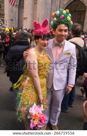 NEW YORK - APRIL 5:  A couple dressed up in Easter attire in front of St. Patrick's Cathedral during The 2015 Easter Parade - stock photo