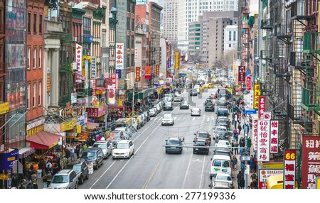 NEW YORK - APRIL 5, 2015: Aerial photo of one of the main streets in Chinatown in New York City.  The neighborhood is home to the largest population of Chinese people in the Western Hemisphere. - stock photo