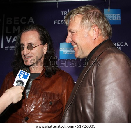 "NEW YORK - APRIL 24: Alex Lifeson and Geddy Lee attend the ""RUSH: Beyond the Lighted Stage"" premiere during the 2010 TriBeCa Film Festival at the School of Visual Arts Theater on April 24, 2010 in New York City. - stock photo"