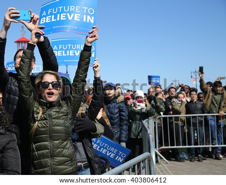 NEW YORK - APRIL 10, 2016:Bernie Sanders supporter during presidential candidate Bernie Sanders rally  at iconic Coney Island boardwalk in Brooklyn, New York - stock photo