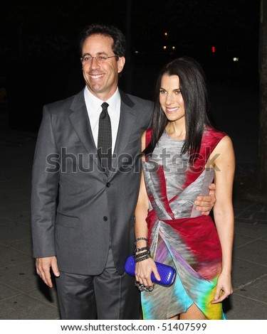 NEW YORK - APRIL 20: Comedian Jerry Seinfeld and wife Jessica arrive at New York State Supreme Court for the Vanity Fair Party during the 2010 Tribeca Film Festival on April 20, 2010 in New York City. - stock photo