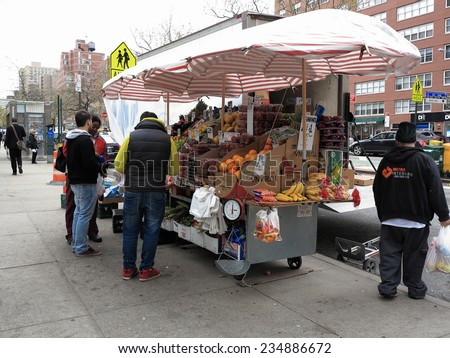 NEW YORK - April 29: Food stand on a Manhattan street on April 29, 2014 in New York. There are more than 10,000 street vendors in NYC. - stock photo