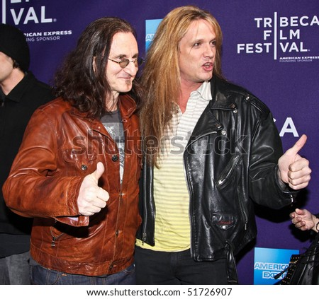 """NEW YORK - APRIL 24: Geddy Lee (L) and Sebastian Bach (R) attend the """"RUSH: Beyond the Lighted Stage"""" premiere during the 2010 TriBeCa Film Festival at the School of Visual Arts Theater on April 24, 2010 in New York City. - stock photo"""