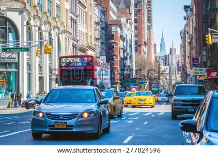 "NEW YORK - APRIL 5, 2015: Intersection of Broadway and Houston St. from SOHO.  The acronym SOHO stands for ""South of Houston St,"" which is famous for its shopping. - stock photo"