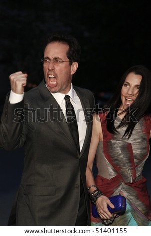 NEW YORK - APRIL 20: Jerry Seinfeld and Jessica Seinfeld arrive at Vanity Fair Party at Tribeca Film Festival on April 20, 2010 in New York City. - stock photo