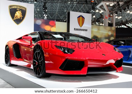 NEW YORK - APRIL 1: Lamborghini exhibit at the 2015 New York International Auto Show during Press day,  public show is running from April 3-12, 2015 in New York, NY. - stock photo