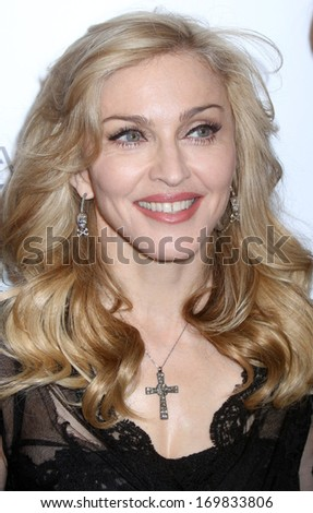 """NEW YORK - APRIL 12: Madonna attends the launch of her """"Truth Or Dare"""" fragrance launch at Macy's on April 12, 2012 in New York City. - stock photo"""