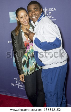 "NEW YORK - APRIL 24: Megan Wollover and Actor Tracy Morgan attend World Premiere of ""The Battle of amfAR"" during the 2013 Tribeca Film Festival on April 24, 2013 in New York - stock photo"