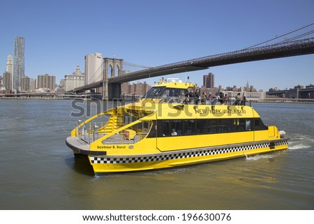 NEW YORK - APRIL 24: New York City Water Taxi under Brooklyn Bridge on April 24, 2104. NYC Water Taxi offering commuter and sightseeing service along the East River and Hudson River  - stock photo