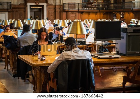 NEW YORK-APRIL 14: Students study at the New York City Public Library on April 14  2014 in Manhattan. The New York City Public Library is the second largest library in the United States. - stock photo