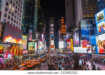 NEW YORK - APRIL 17, 2012: Thousands of people crossing Times square on April 17, 2012 in New York City. Times Square became smoke free in February 2012. - stock photo