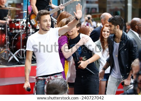 NEW YORK-AUG 26: (L-R) Liam Payne of One Direction performs on NBC's 'Today Show' at Rockefeller Plaza on August 23, 2013 in New York City. - stock photo