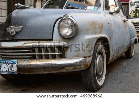 New York, August 15, 2016: An old Studebaker car in need of restoration is parked in the street in Manhattan.