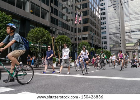 NEW YORK - AUGUST 17:  Bicyclist, joggers and walkers enjoy Car Free Streets on Park Ave as part of New York City's Summer Streets August 17, 2013 in New York City.  - stock photo