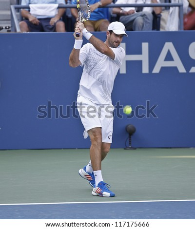 NEW YORK - AUGUST 31: Brian Baker of USA returns ball during 2nd round match against Janko Tipsarevic of Serbia at US Open tennis tournament on August 31, 2012 in Flushing Meadows New York