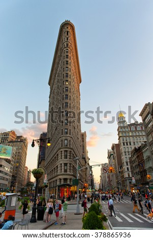 NEW YORK - AUGUST 27: Busy Street Scene on Fifth Avenue in front of Historic Flatiron Building at Dusk  . August 27, 2015 in Manhattan, New York City - stock photo