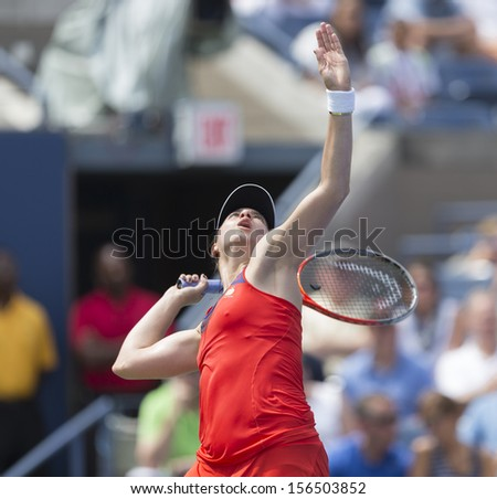NEW YORK - AUGUST 31: Christina McHale of USA returns ball during 3rd round match against Ana Ivanovic of Serbia at 2013 US Open at USTA Billie Jean King Tennis Center on August 31, 2013 in New York - stock photo