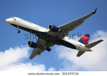 NEW YORK - AUGUST 13, 2015: Delta Airlines Boeing 757 descending for landing at JFK International Airport in New York. Aircraft named after New York Yankees Hall of Fame Pitcher Mariano Rivera 42 - stock photo