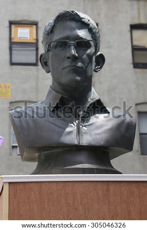 NEW YORK - AUGUST 8, 2015: Edward Snowden statue in Little Italy during LoMan Arts Festival in Manhattan - stock photo
